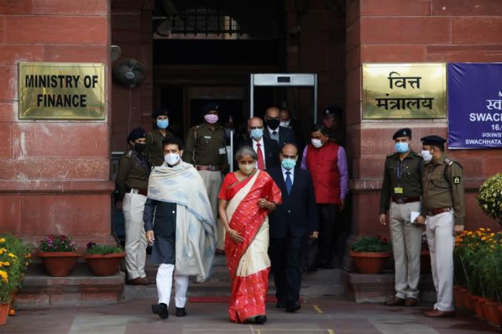 India's Finance Minister Nirmala Sitharaman and Minister of State for Finance and Corporate Affairs Anurag Thakur walk as she leaves her office to present the federal budget in the parliament in New Delhi