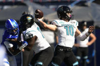 Coastal Carolina quarterback Grayson McCall passes for a touchdown as Georgia State linebacker Jordan Strachan (7) is blocked by offensive lineman Antwine Loper (72) during the first half of an NCAA football game Saturday, Oct. 31, 2020, in Atlanta. (AP Photo/John Amis)