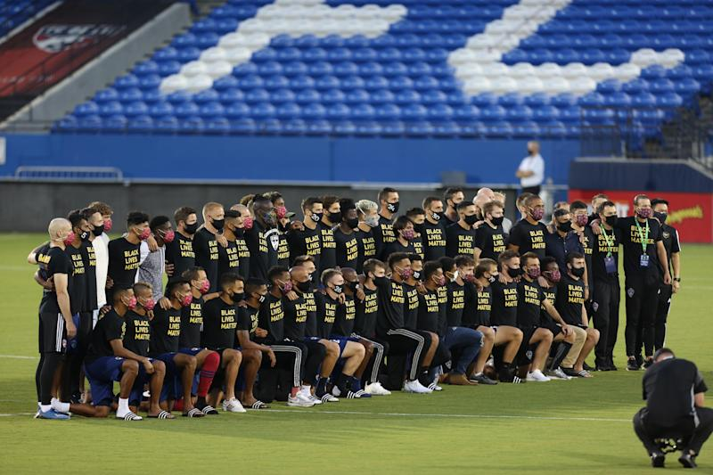 FRISCO, TX - AUGUST 26: The entire FC Dallas team and staff pose after it was announced that the game was postponed between FC Dallas and Colorado Rapids as part of the Major League Soccer 2020 at Toyota Stadium on August 26, 2020 in Frisco, Texas. Several sporting leagues across the nation today are postponing their schedules as players protest the shooting of Jacob Blake by Kenosha, Wisconsin police. (Photo by Omar Vega/Getty Images)