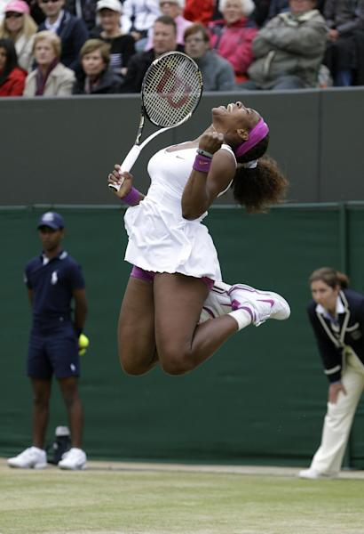 Serena Williams of the United States reacts after defeating Yaroslava Shvedova of Kazakhstan during a fourth round singles match at the All England Lawn Tennis Championships at Wimbledon, England, Monday, July 2, 2012. (AP Photo/Kirsty Wigglesworth)