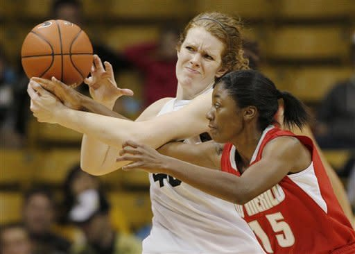New Mexico guard Antiesha Brown, front, tips the ball away from Colorado center Rachel Hargis for a steal during the first half of an NCAA college basketball game in Boulder, Colo., on Saturday, Dec. 29, 2012. (AP Photo/David Zalubowski)