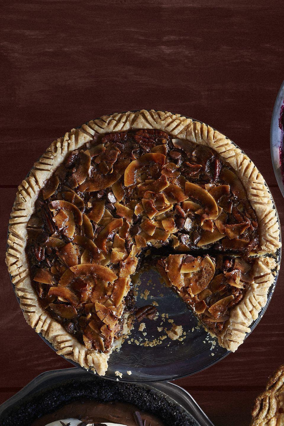 "<p>Sure, pecan pie is great on its own, but the addition of coconut and chocolate adds layers of delicious flavor.</p><p><strong><a href=""https://www.countryliving.com/food-drinks/recipes/a36551/chocolate-coconut-pecan-pie/"" rel=""nofollow noopener"" target=""_blank"" data-ylk=""slk:Get the recipe."" class=""link rapid-noclick-resp"">Get the recipe.</a></strong></p>"