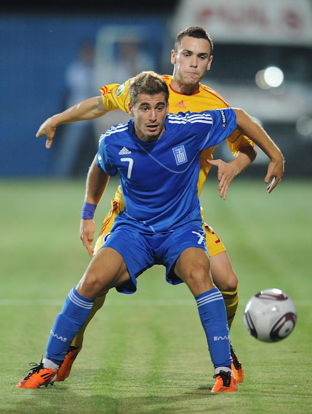 Lucian Murgoci (R) of Romania vies with Charis Mavrias (L) of Greece during the final football match of the UEFA European Under-19 Championship 2010/2011 in Berceni village next to Bucharest July 23, 2011. AFP PHOTO/DANIEL MIHAILESCU (Photo credit should read DANIEL MIHAILESCU/AFP/Getty Images)
