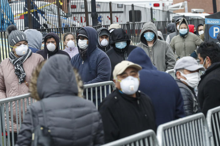 Patients line up for a COVID-19 test at the Elmhurst Hospital Center in New York, March 25, 2020. (John Minchillo / AP)