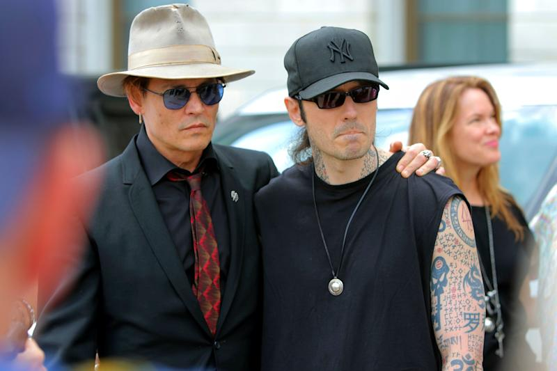 Actor Johnny Depp, left, stands with former Arkansas death row inmate Damien Echols, before speaking at a rally. - Credit: Stephen B Thornton/AP