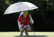 Jin Young Ko, of South Korea, lines up a putt on the 18th hole during the first round of the women's golf event at the 2020 Summer Olympics, Wednesday, Aug. 4, 2021, at the Kasumigaseki Country Club in Kawagoe, Japan. (AP Photo/Andy Wong)