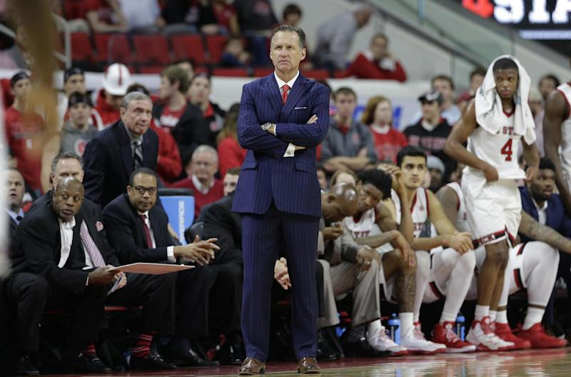 In this Wednesday, Feb. 15, 2017, photo, North Carolina State head coach Mark Gottfried watches during the second half of an NCAA college basketball game against North Carolina in Raleigh, N.C. North Carolina State says Gottfried won't return for a seventh season but will coach the remainder of this season. (AP Photo/Gerry Broome)