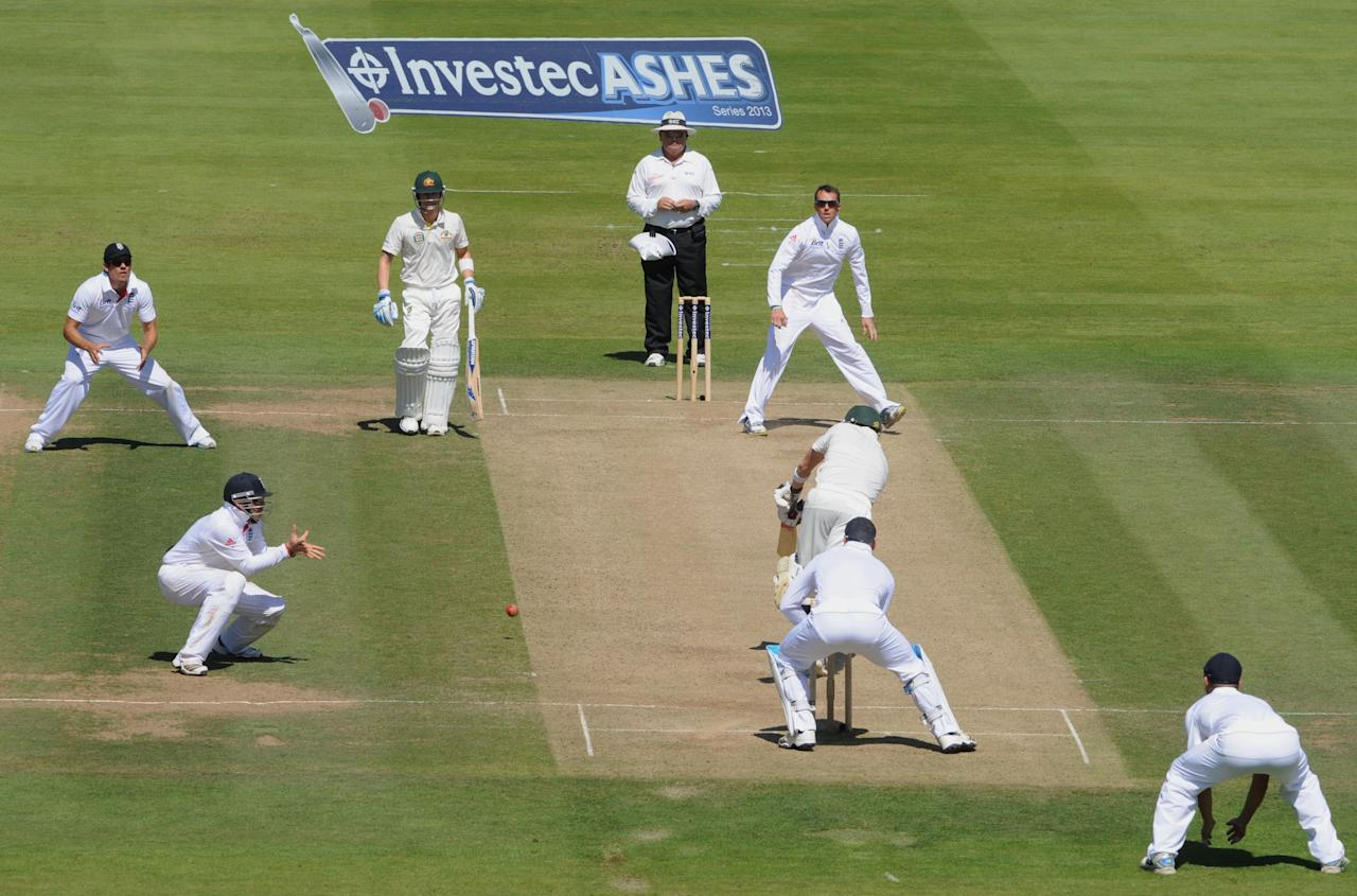 England's Graeme Swann looks-on as Ian Bell (left) takes the catch of Australia's Steven Smith on day two of the Second Investec Ashes Test at Lord's Cricket Ground, London.