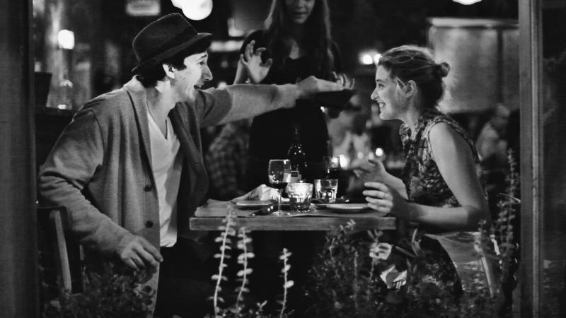 "This undated publicity photo released by the Independent Film Channel shows Greta Gerwig, right, as Frances, with Adam Driver as Lev having dinner in a scene from the film, ""Frances Ha."" As an iconoclastic group, modern black-and-white movies stand out for their classical photography and their willful connection to an earlier period of filmmaking.(AP Photo/IFC)"