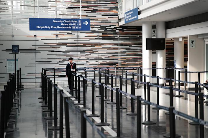 An empty security checkpoint at O'Hare International Airport in Chicago, March 12, 2020. (Scott Olson/Getty Images)