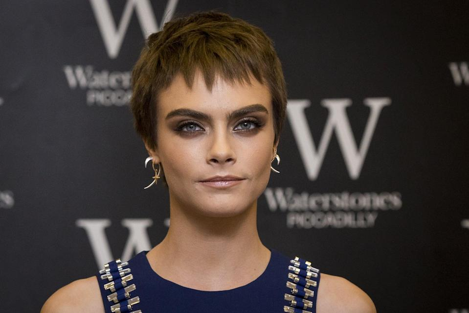 <p>Before going platinum, Delevingne dyed her choppy pixie - complete with micro-fringe - brunette. </p>