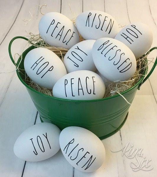 """<p>Create a simple, yet meaningful, Easter egg decoration with this idea that uses reflective words for the holiday.</p><p><strong>Get the tutorial at <a href=""""https://www.thekimsixfix.com/2018/02/diy-rae-dunn-inspired-easter-eggs-video.html"""" target=""""_blank"""">The Kim Six Fix</a>.</strong></p><p><strong><a class=""""body-btn-link"""" href=""""https://www.amazon.com/Inkjet-Transfers-Paper-8-5x11-PPD001-10/dp/B004BF6BZI/?tag=syn-yahoo-20&ascsubtag=%5Bartid%7C10050.g.30928377%5Bsrc%7Cyahoo-us"""" target=""""_blank"""">SHOP TRANSFER PAPER</a><br></strong></p>"""