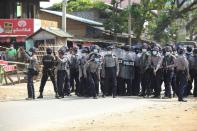 Riot police stand in the middle of a street during a protest against the military coup, in Naypyitaw