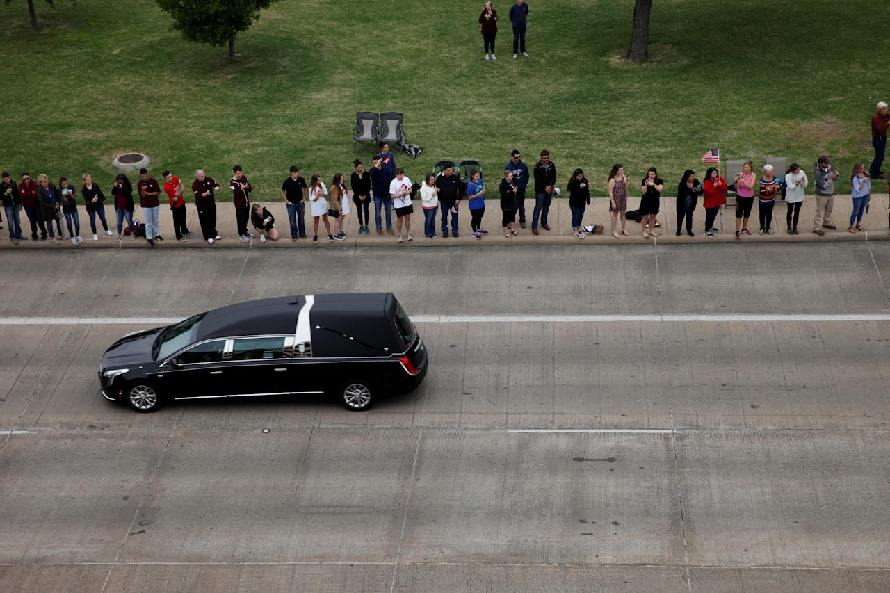 <p>The hearse carrying former first lady, Barbara Bush, drives past onlookers on George Bush Drive, followed by her husband, former U.S. President George H.W. Bush, son, former President George W. Bush, and their family to the George Bush Presidential Library and Museum for her burial in College Station, Texas, April 21, 2018. (Photo: Spencer Selvidge/Reuters) </p>