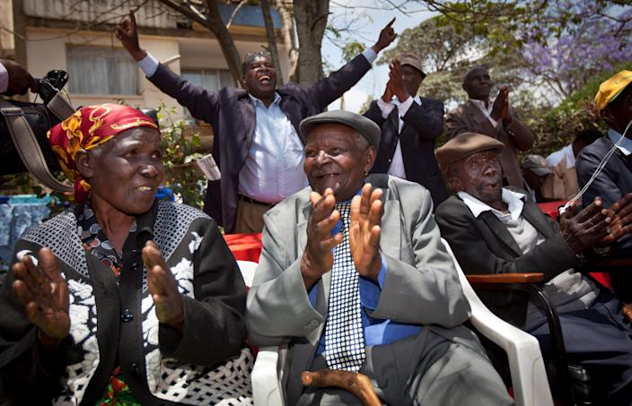 Kenyans celebrate the announcement of a legal decision in their case at Britain's High Court concerning Mau Mau veterans.
