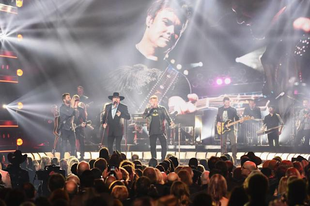<p>Dierks Bentley, Eddie Montgomery, Gary LeVox, and Jay DeMarcus perform onstage at the 51st annual CMA Awards at the Bridgestone Arena on November 8, 2017 in Nashville, Tennessee. (Photo by Rick Diamond/Getty Images) </p>