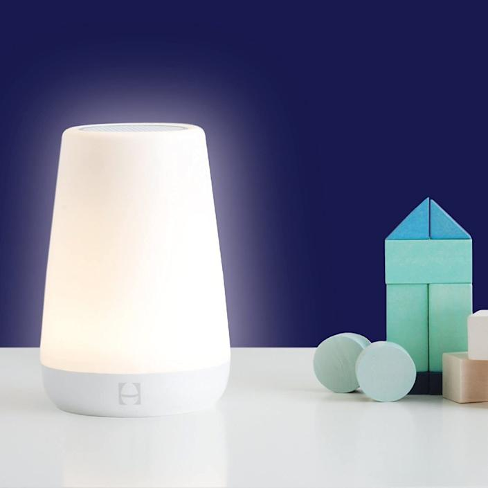 "It's a night light, sound machine and alarm all in one device, making it easy for your little ones (and partner) to get a good night's sleep and wake up on time in the morning.<br /><br /><strong>Promising review:</strong> ""I love this lamp/white noise machine. I bought a second one, and now everyone in the family wants one (the adults and teen alike!). <strong>The options for lamp brightness/dimness, noise volume, and types of white noise are great.</strong> <strong>We were able to drown out fireworks for my son that were going off right over our house.</strong> The touch option for on/off is great; there is a toddler lock feature we love; you are able to program green-to-rise for kiddos to stay in their rooms until it turns a certain color and I love being able to control it from my phone."" — <a href=""https://amzn.to/3mNwTjy"" target=""_blank"" rel=""noopener noreferrer"">H.P.</a><br /><br /><strong>Get it from Amazon for <a href=""https://amzn.to/3dmhh3u"" target=""_blank"" rel=""noopener noreferrer"">$59.99</a>. </strong>"