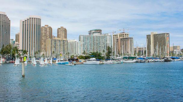 PHOTO: The skyline of Honolulu is captured from a boat marina. (Education Images/UIG via Getty Images)