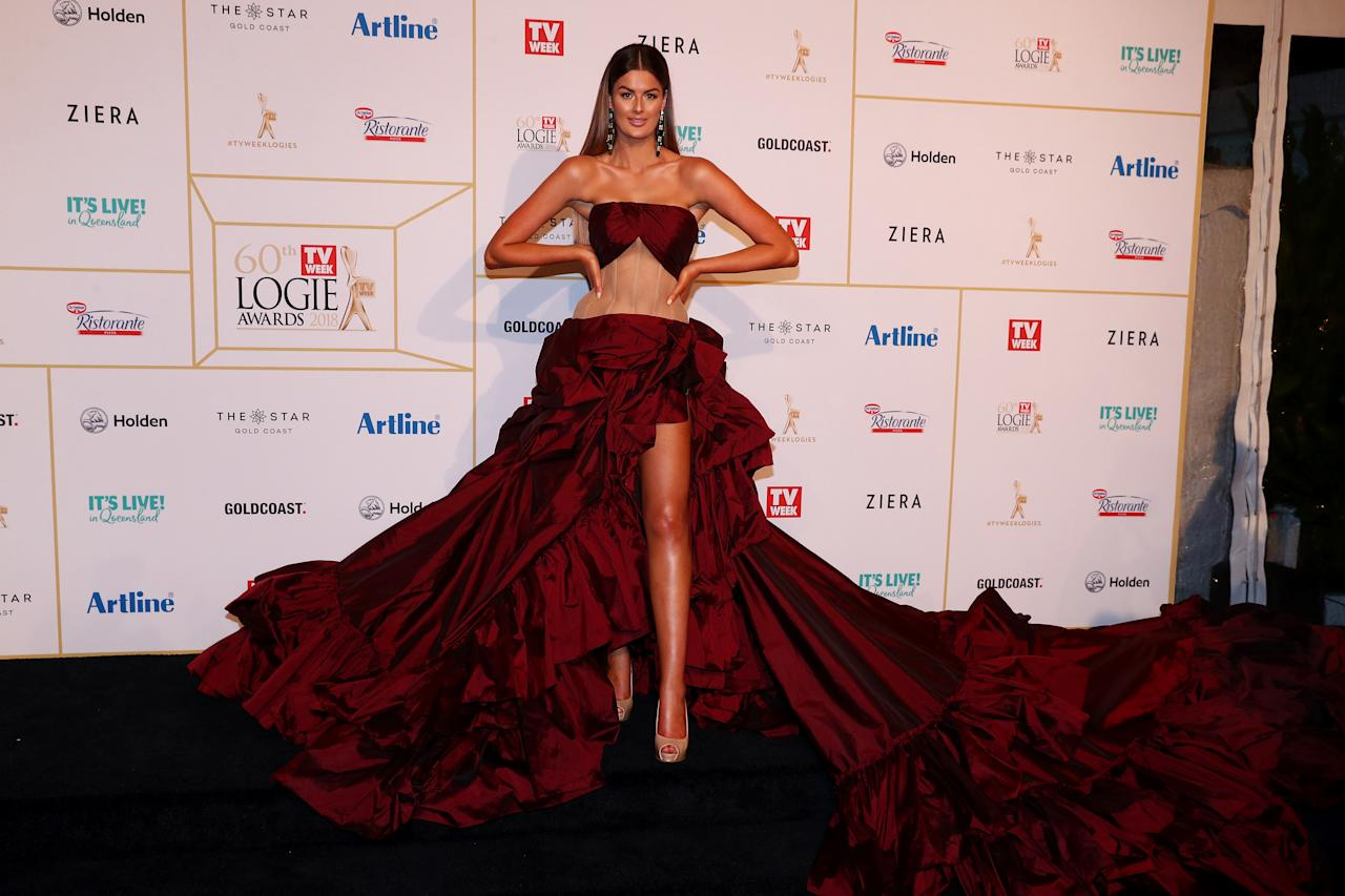 <p>The Married at First Sight star did not hold back in this burgundy Alin Le Kal design with a sheer midsection and billowing train.<br /> Photo: Getty </p>