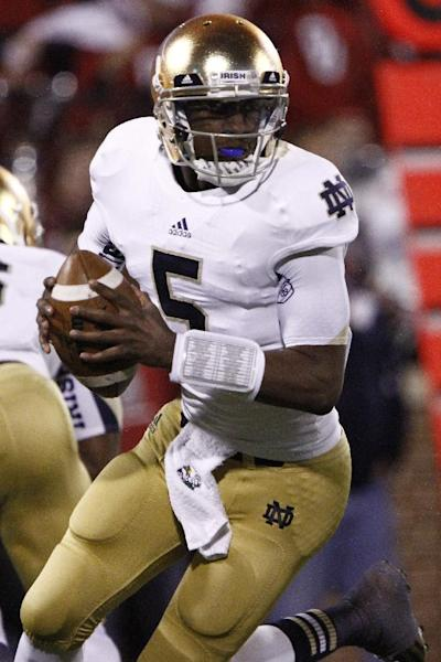 Notre Dame quarterback Everett Golson (5) looks to pass against Oklahoma during the second quarter of an NCAA college football game in Norman, Okla., Saturday, Oct. 27, 2012. Notre Dame won 30-13. (AP Photo/Alonzo Adams)