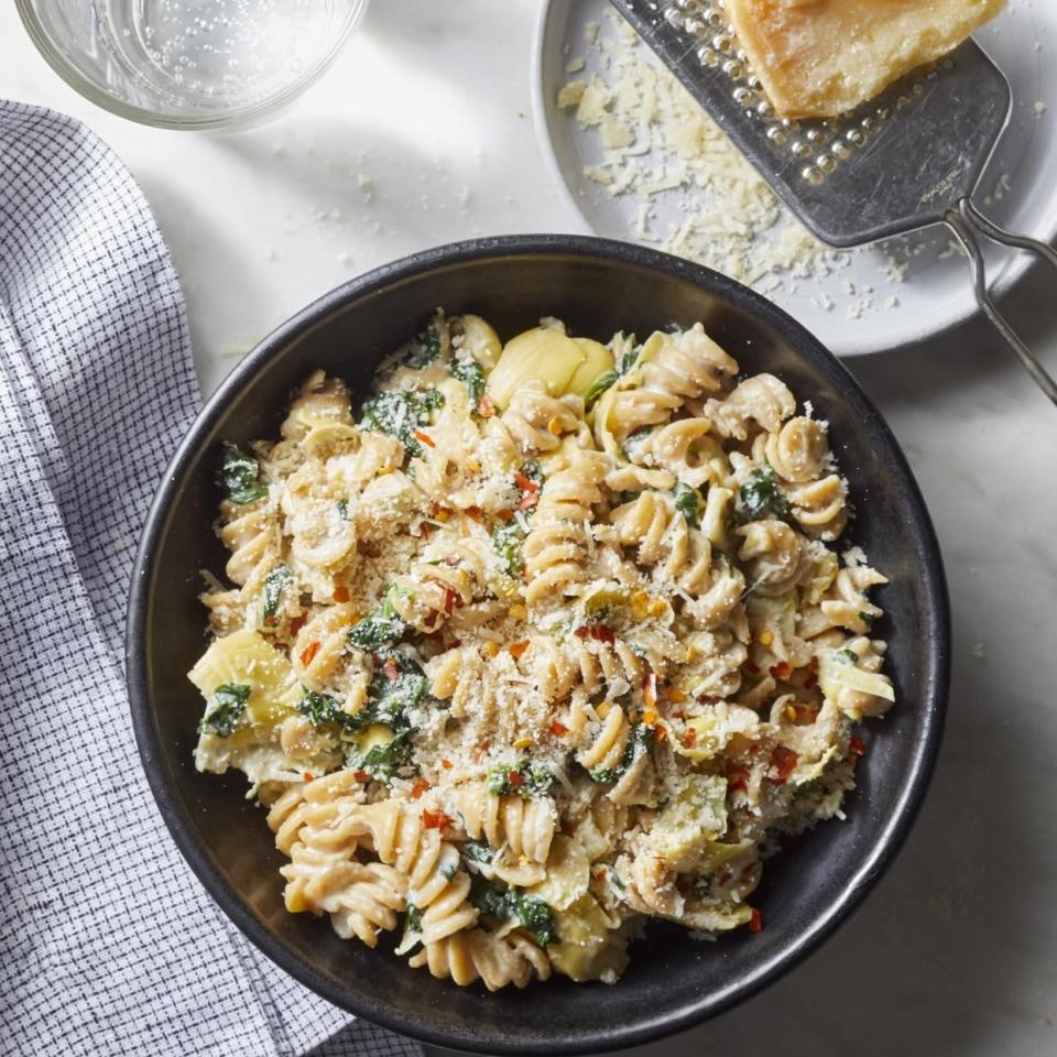 "<p>If you've ever wanted to make a meal out of warm spinach and artichoke dip, this creamy pasta is for you. And here's what's almost as good as the flavor of this comforting dish: the fact that this healthy dinner takes just 20 minutes to prepare. <a href=""http://www.eatingwell.com/recipe/276095/spinach-artichoke-dip-pasta/"" rel=""nofollow noopener"" target=""_blank"" data-ylk=""slk:View recipe"" class=""link rapid-noclick-resp""> View recipe </a></p>"