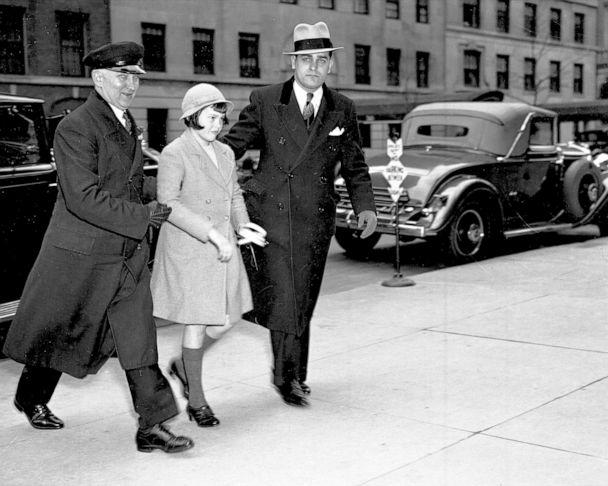 PHOTO:Assisted by chauffeur, Gloria Vanderbilt returns to mother's home after attending Palm Sunday services at Church of St. Francis of Assisi, April 14, 1935. (New York Daily News Archive via Getty Images)