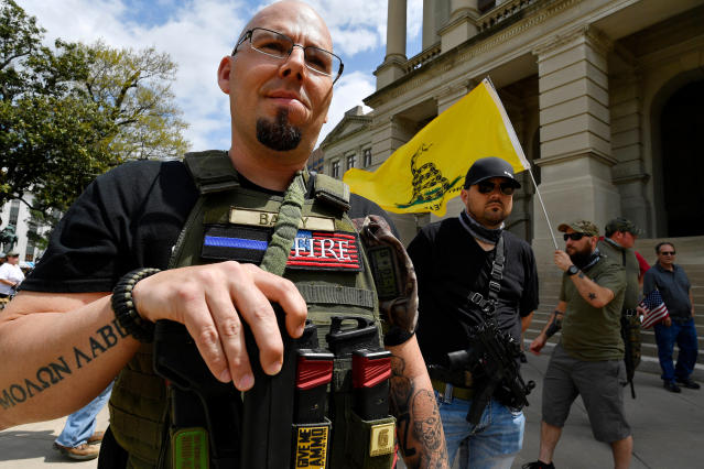 <p>Shaun Baby, of Cartersville, Ga., participates in a gun-rights rally at the state capitol, Saturday, April 14, 2018, in Atlanta, Ga. (Photo: Mike Stewart/AP) </p>
