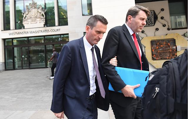 Lord Holmes of Richmond (left) leaves Westminster Magistrates' Court, London where he appeared on charges of sexual assault. (PA Images)