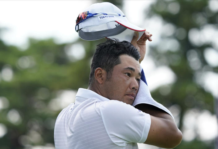 Hideki Matsuyama of Japan dries his sweat on10th hole during the second round of the men's golf event at the 2020 Summer Olympics on Friday, July 30, 2021, at the Kasumigaseki Country Club in Kawagoe, Japan. (AP Photo/Matt York)
