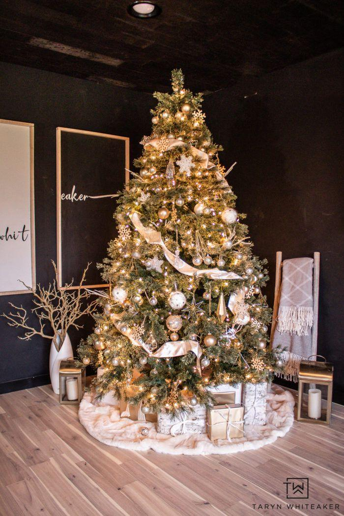 """<p>Neutral and cozy but still totally glam, a cream and gold scheme is sure to set your tree apart. </p><p><strong><em>Get the tutorial at <a href=""""https://tarynwhiteaker.com/modern-cream-and-gold-christmas-tree/"""" rel=""""nofollow noopener"""" target=""""_blank"""" data-ylk=""""slk:Taryn Whiteaker Designs"""" class=""""link rapid-noclick-resp"""">Taryn Whiteaker Designs</a>. </em></strong></p><p><a class=""""link rapid-noclick-resp"""" href=""""https://www.amazon.com/Champagne-Double-Faced-Satin-Ribbon/dp/B01N4RGTA8?tag=syn-yahoo-20&ascsubtag=%5Bartid%7C10070.g.2025%5Bsrc%7Cyahoo-us"""" rel=""""nofollow noopener"""" target=""""_blank"""" data-ylk=""""slk:SHOP CHAMPAGNE RIBBON"""">SHOP CHAMPAGNE RIBBON</a></p>"""