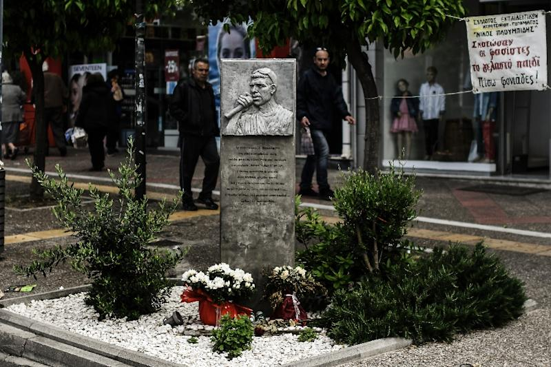 A memorial to the Greek RAP singer Pavlos Fyssas who was fatally stabbed in 2013 and whose family claims he was ambushed on orders from senior Golden Dawn party brass (AFP Photo/Aris MESSINIS)