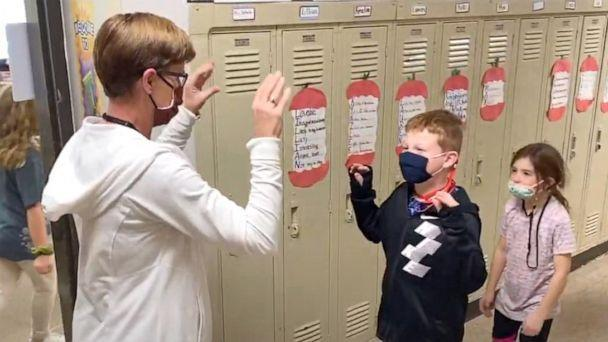 PHOTO: Mary Schulz, an elementary school teacher in Iowa, does a special distance greeting with each of her students. (Mary Schulz)