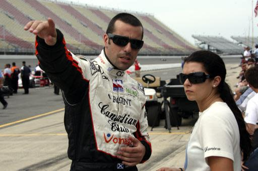 FILE - In this Aug. 4, 2007, file photo, Dario Franchitti, of Scotland, talks with teammate Danica Patrick after his qualification run at Michigan International Speedway in Brooklyn, Mich. Franchitti qualified for the IndyCar Series' Firestone Indy 400 auto race on the pole with a speed of 218.308 mph. Patrick is closing out her racing career this Sunday in the Indianapolis 500. (AP Photo/Bob Brodbeck, File)