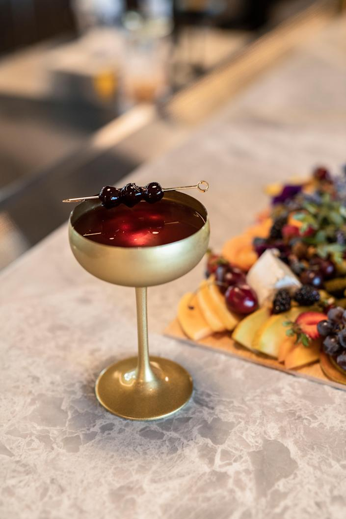 Cocktails and bites are curated by h.wood Group.