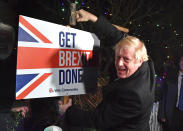 """FILE - In this Wednesday, Dec. 11, 2019 file photo, Britain's Prime Minister and Conservative party leader Boris Johnson poses as he hammers a """"Get Brexit Done"""" sign into the garden of a supporter, in Benfleet, England, on the final day of campaigning for the general election. It's more than four years since Britain voted to leave the European Union, and almost a year since Prime Minister Boris Johnson won an election by vowing to """"get Brexit done."""" Spoiler alert: It is not done. As negotiators from the two sides hunker down for their final weeks of talks on an elusive trade agreement, Britain and the EU still don't know whether they will begin 2021 with an organized partnership or a messy rivalry. (Ben Stansall/Pool Photo via AP)"""