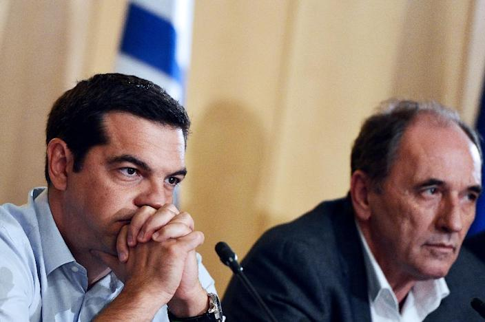 Greek Prime Minister Alexis Tsipras (L) and Greek Economy Minister Giorgos Stathakis deliver a press conference after their meetings at the Greek Ministry of Infrastructure, Transport and Networks in Athens on August 12, 2015 (AFP Photo/Louisa Gouliamaki)