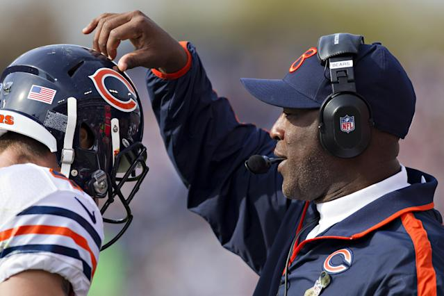 NASHVILLE, TN - NOVEMBER 4: Head coach Lovie Smith of the Chicago Bears pats a player on the helmet as he comes off the field during a game against the Tennessee Titans at LP Field on November 4, 2012 in Nashville, Tennessee. The Bears defeated the Titans 51-20. (Photo by Wesley Hitt/Getty Images)