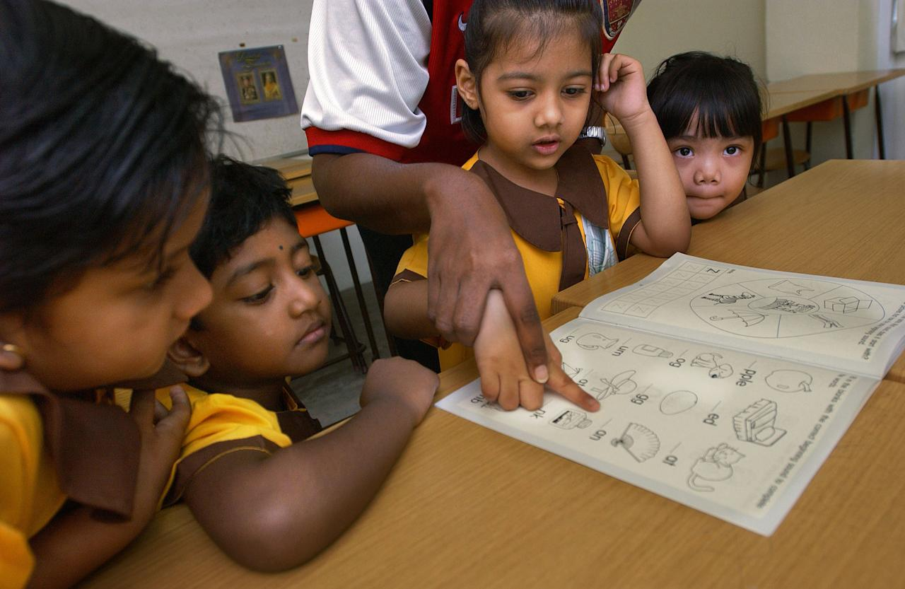402362 13: Indian, Malay, and Chinese students learn together at the Wisma Dharma Candra school March 11, 2002 in Kuala Lumpur, Malaysia. Though officially an Islamic country, Malaysia is a multiethnic and multireligious society, with a population that is half Muslim, a quarter Chinese Buddhists, and ten percent Hindu from India. In an age of ethnic strife, poverty, and civil war, Malaysians have managed to forge a peaceful and prosperous multiethnic society. (Photo by Chris Hondros/Getty Images)