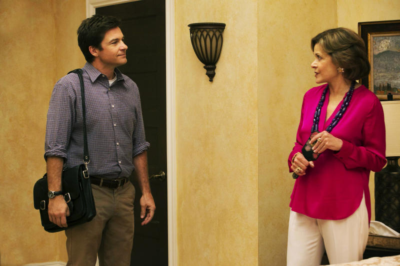 "This undated publicity photo provided by Netflix shows Jason Bateman, left, and Jessica Walter in a scene from the new season of ""Arrested Development"" on Netflix. Even Walter, an Emmy-winning character actress, is surprised to find herself at a new professional peak, thanks to the Netflix revival of her sitcom ""Arrested Development"" as well as the continued success of the animated FX cult favorite, ""Archer."" The new season for ""Arrested Development"" began Sunday, May 26, 2013. (AP Photo/Netflix, Mike Yarish)"