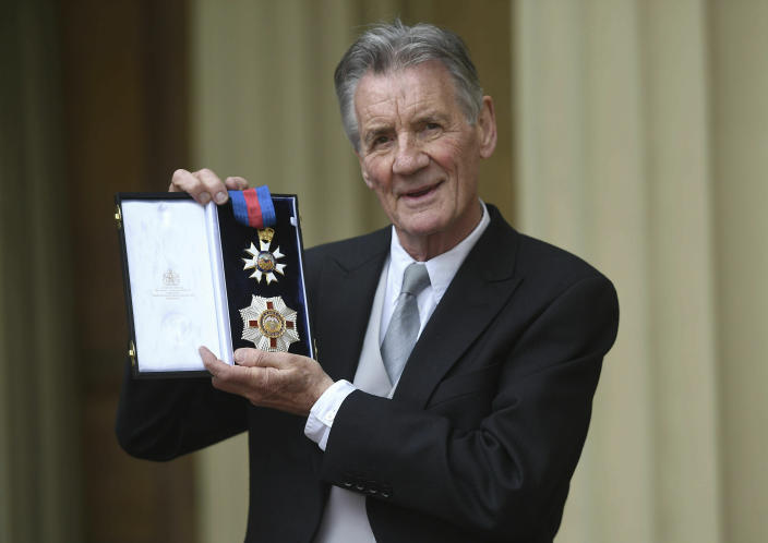 Michael Palin poses for a photo after he was made a Knight Commander of the Order of St Michael and St George by Prince William during an investiture ceremony at Buckingham Palace, London, Wednesday June 12, 2019. (David Mirzoeff Pool Photo via AP)