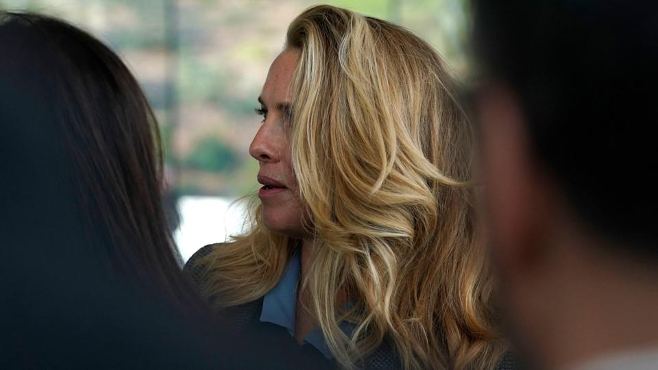 Mandatory Credit: Photo by Tony Avelar/AP/Shutterstock (10167440a)Laurene Powell, the widow of Steve Jobs, waits to enter the Steve Jobs Theater for an event to announce new products, in Cupertino, CalifApple Streaming TV, Cupertino, USA - 25 Mar 2019.