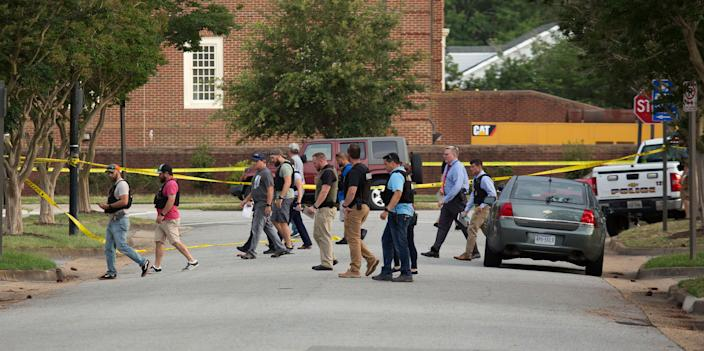 Police work the scene where eleven people were killed during a mass shooting at the Virginia Beach city public works building, May 31, 2019 in Virginia Beach, Va. (Photo: L. Todd Spencer/The Virginian-Pilot via AP)