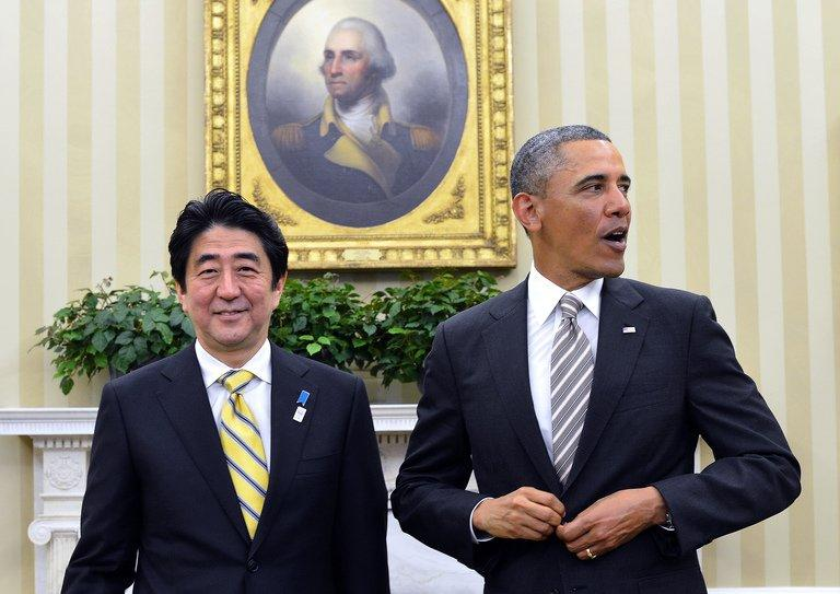 US President Barack Obama (R) and Japan's Prime Minister Shinzo Abe finish their bilateral meeting in the Oval Office at the White House, in Washington, DC, on February 22, 2013. Obama said the US and Japan are committed to 'strong actions' in response to North Korea's 'provocations' as he welcomed Japan's premier