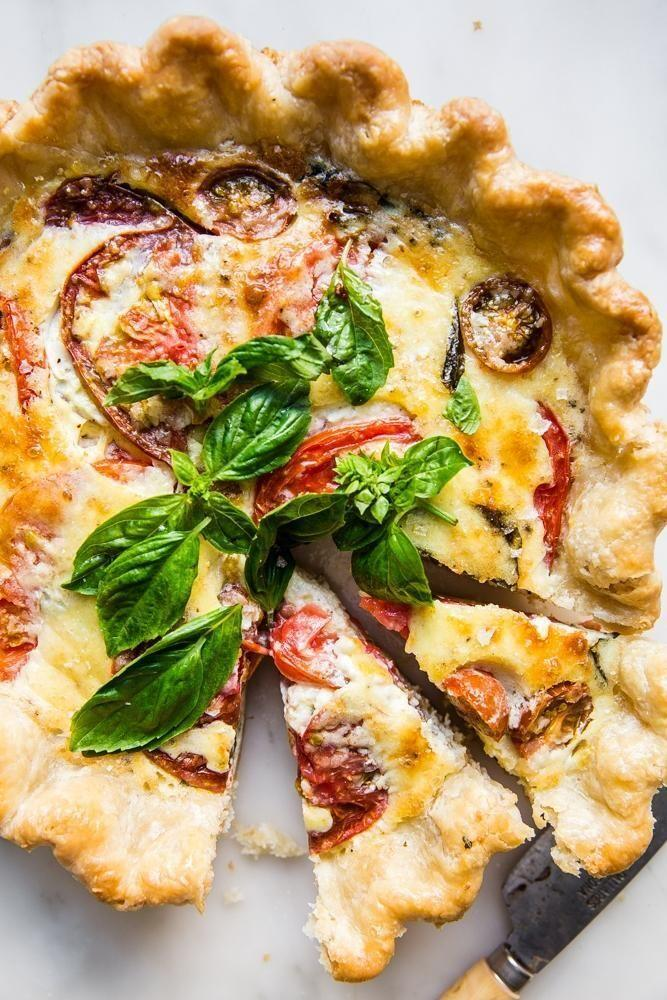 """<p>This quiche is guaranteed to impress at any summer get-together. It works as a brunch recipe or as an appetizer at your dinner party, too.</p><p><strong>Get the recipe at <a href=""""https://themodernproper.com/tomato-basil-and-caramelized-onion-quiche"""" rel=""""nofollow noopener"""" target=""""_blank"""" data-ylk=""""slk:The Modern Proper"""" class=""""link rapid-noclick-resp"""">The Modern Proper</a>.</strong></p><p><a class=""""link rapid-noclick-resp"""" href=""""https://go.redirectingat.com?id=74968X1596630&url=https%3A%2F%2Fwww.walmart.com%2Fsearch%2F%3Fquery%3Dpioneer%2Bwoman%2Bpie%2Bpan&sref=https%3A%2F%2Fwww.thepioneerwoman.com%2Ffood-cooking%2Fmeals-menus%2Fg36500577%2Ftomato-recipes%2F"""" rel=""""nofollow noopener"""" target=""""_blank"""" data-ylk=""""slk:SHOP PIE PANS"""">SHOP PIE PANS</a></p>"""