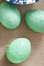 "<p>Use white Puffy Paint to dot the raised patterns on eggs. Once dry, paint eggs with glossy green acrylic paint.</p><p><a class=""link rapid-noclick-resp"" href=""https://www.amazon.com/Tulip-16070-Dimensional-Fabric-Paint/dp/B007RAQTSS/ref=sr_1_7?tag=syn-yahoo-20&ascsubtag=%5Bartid%7C10050.g.1282%5Bsrc%7Cyahoo-us"" rel=""nofollow noopener"" target=""_blank"" data-ylk=""slk:SHOP 3D PAINT"">SHOP 3D PAINT</a></p>"