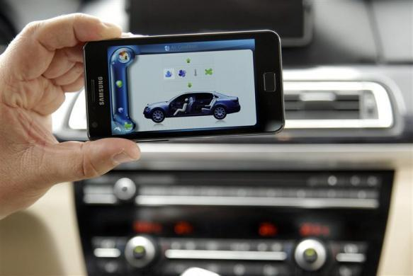 A man presents a Harman Car Connectivity System controlled with a smartphone during the opening day of the IFA consumer electronics fair in Berlin, August 31, 2012.