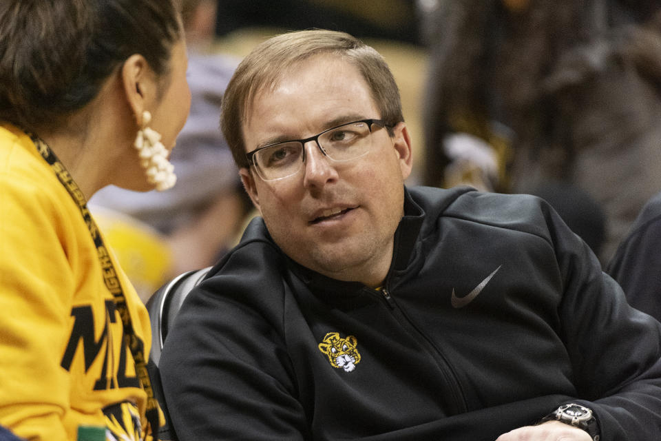 Missouri football coach Eliah Drinkwitz talks with a fan during an NCAA college basketball game on Jan. 11. (AP)