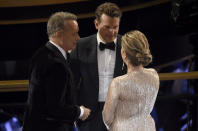 Tom Hanks, from left, Bradley Cooper and Rita Wilson speak in the audience at the Oscars on Sunday, Feb. 9, 2020, at the Dolby Theatre in Los Angeles. (AP Photo/Chris Pizzello)