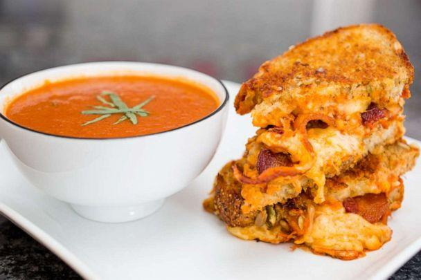 PHOTO: Smoky tomato soup with fresh tarragon and buffalo chicken grilled cheese from Jaymee Sire. (Justin Aharoni)