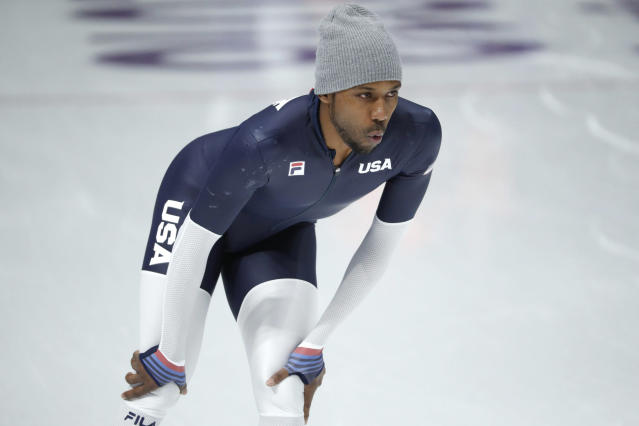 Shani Davis didn't walk with the Americans during the Opening Ceremony. (AP)